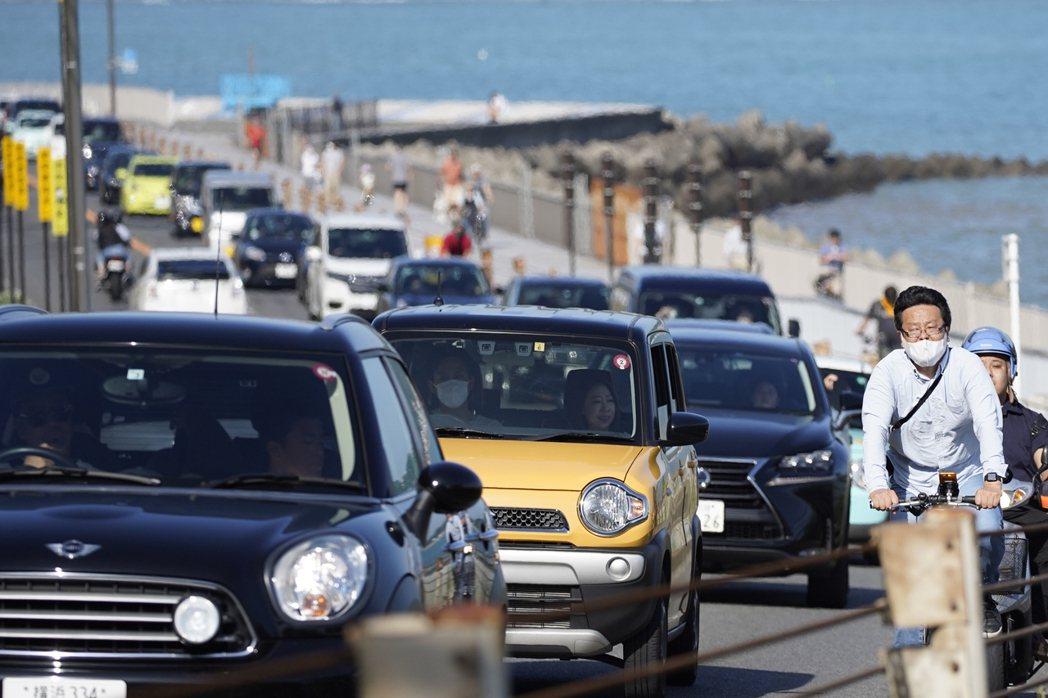 日本年輕人不買車也不愛養車,迫使日本車廠推出共享汽車和訂閱服務。美聯社