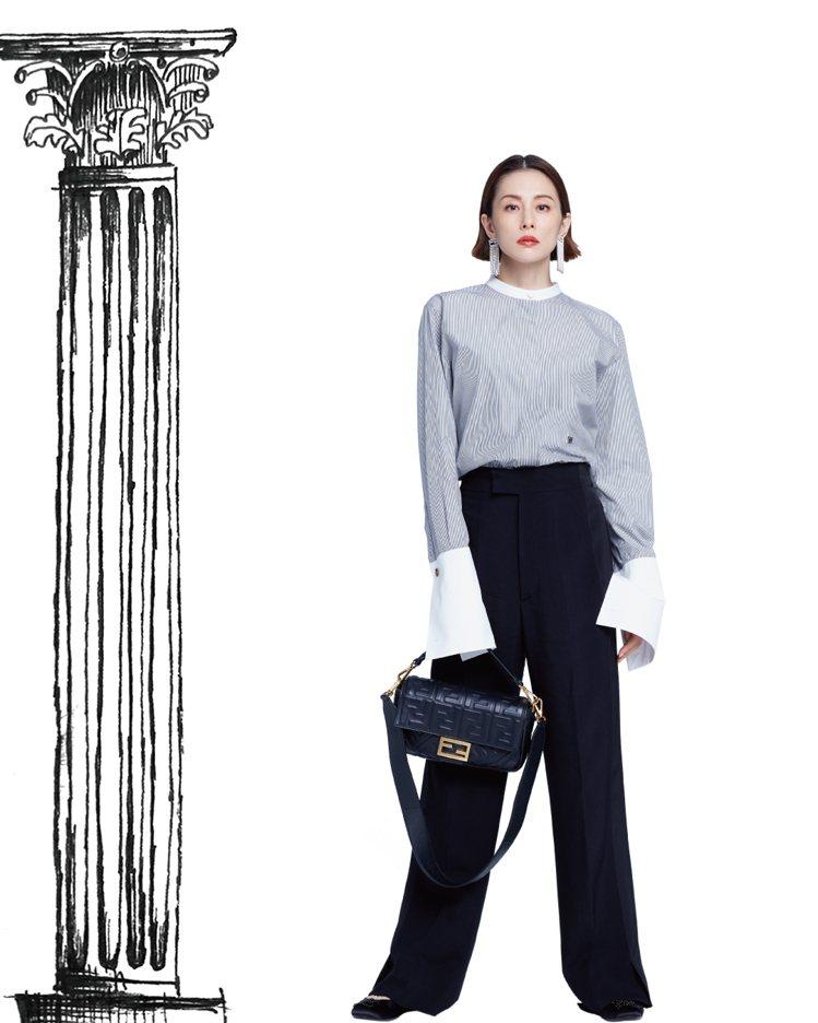 米倉涼子以帥氣的襯衫和西褲搭配Baguette包款,展現自信女人味攝。圖/FEN...