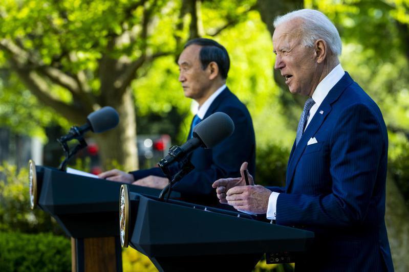 拜登總統與日本首相菅義偉會談。 歐新社