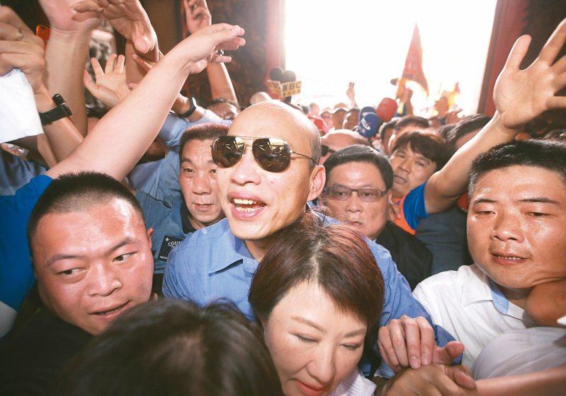 據傳韓國瑜將於明天臉書宣布是否參選國民黨主席,不過高雄市府前發言人王淺秋受訪已否認韓明天有任何宣布。圖/聯合報系資料照片