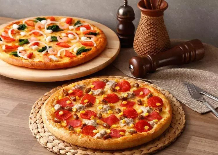達美樂將於4月22日推出外帶大披薩222元的限時優惠。圖/取自達美樂披薩粉絲頁