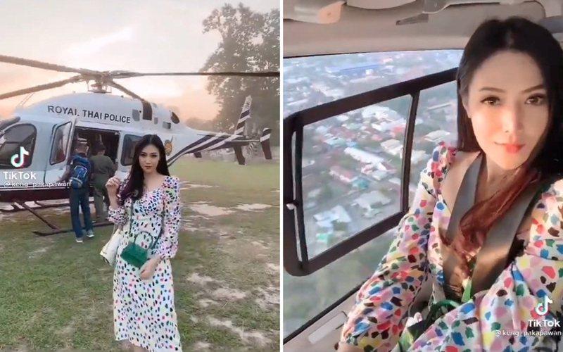 從網路上流傳的短片可見,該人妻在寫有「泰國皇家警察」的飛機前拍照留念。 圖/twitter「Erich Parpart」影片截圖