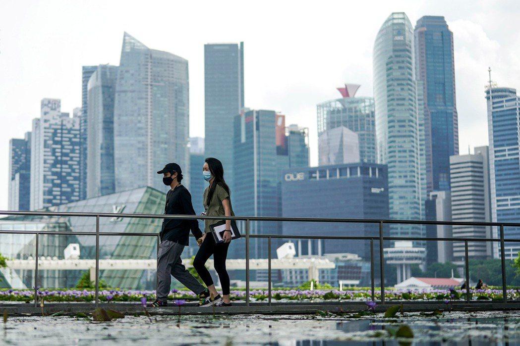 新加坡薪資水準高於台灣,房價卻相對較低。 歐新社
