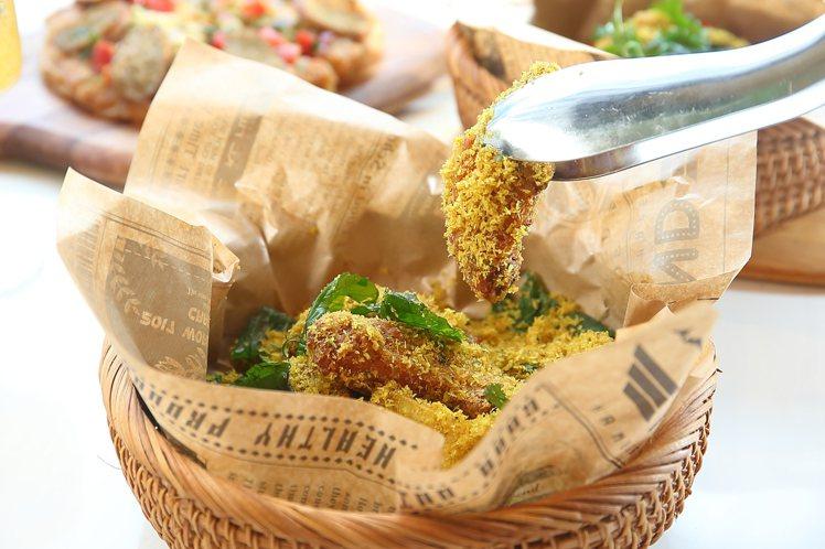 誠品南西店搶先獨家推出的「酥炸綠咖哩椰香雞翅」,每份285元。記者陳睿中/攝影