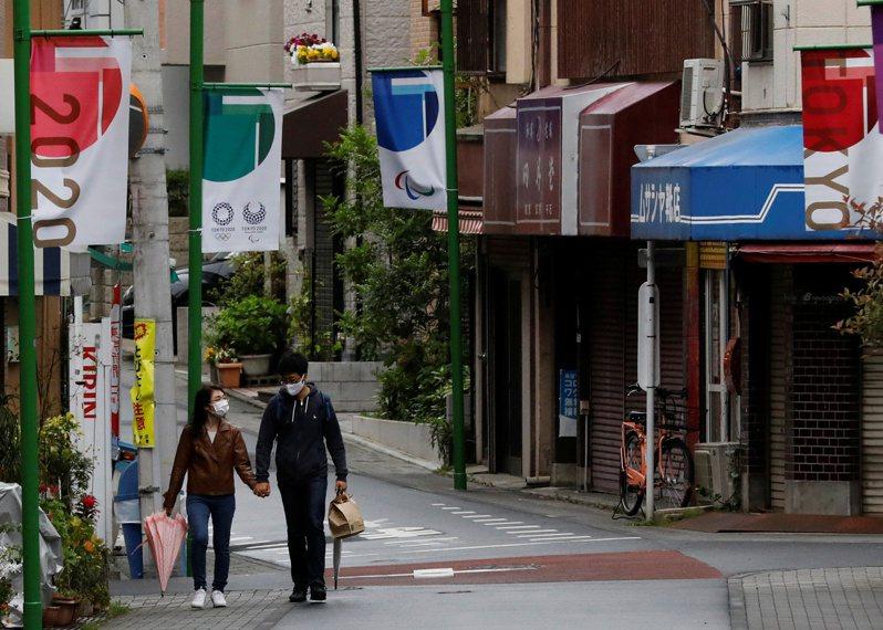 亞銀首席經濟學家澤田康幸表示,「新疫情持續爆發,部分是由變異病毒引起,且許多亞洲經濟體在疫苗採購及管理上都面臨挑戰」。圖為日本街景。 圖/路透社