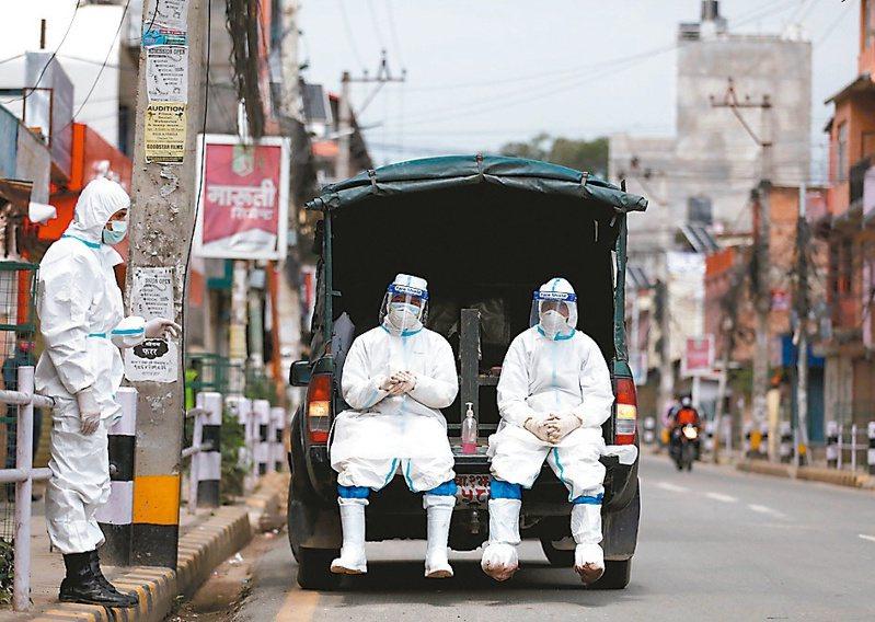 亞洲許多經濟體隨疫情復熾陷入泥淖,台灣與南韓展望相對看好。 (路透)
