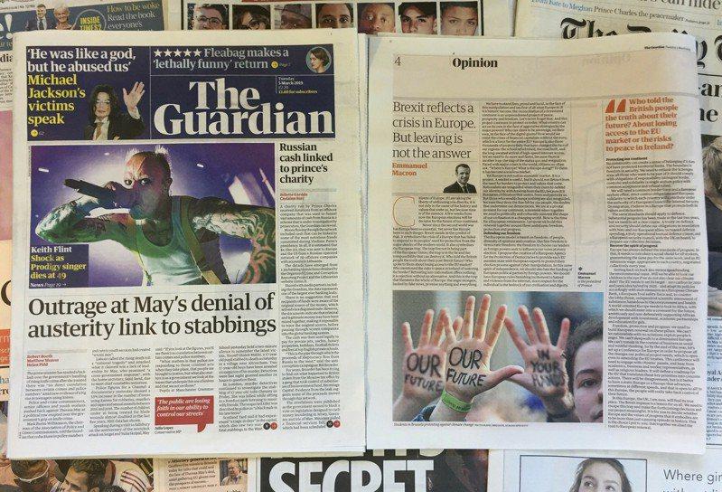 今年是英國衛報(the Guardian)創立200周年。圖為法國總統馬克宏2019年3月投書衛報。美聯社