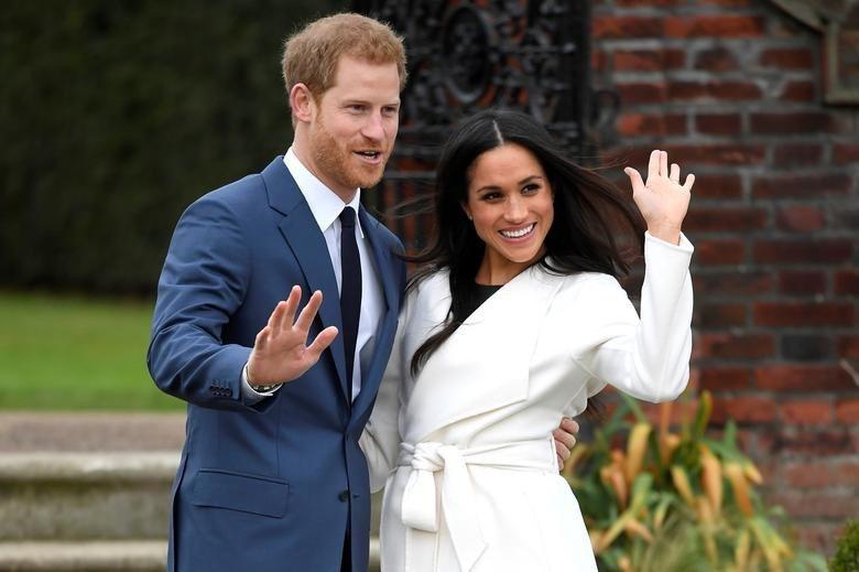 英國記者稱皇室人員堅信梅根(右)洗腦哈利。圖/路透資料照片