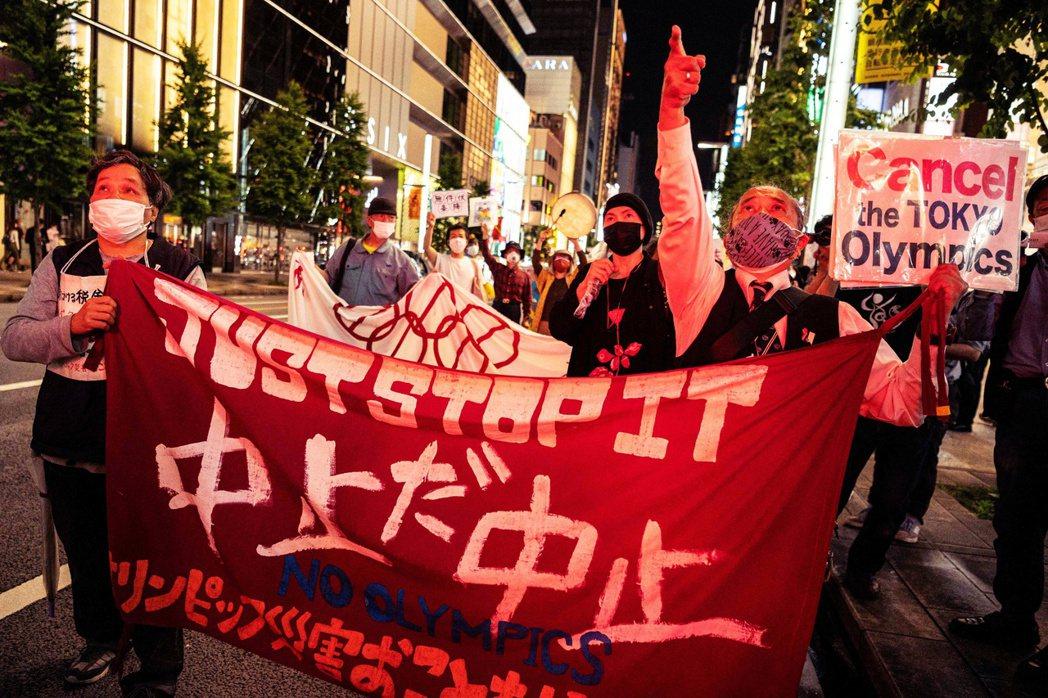 圖/法新社:對於7月的東京奧運已剩下2個月時間的日本來說,要完成全面施打更是不可...