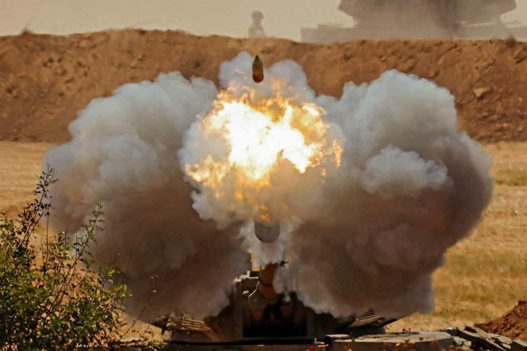 目前,連續11天的以色列-加薩互轟戰將會全面中止、暫告一段落。 圖/法新社