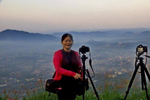 62歲楊淑貞預定今年退休,她早已做好準備,用照相機與先生一起寫人生的第二春。 圖...
