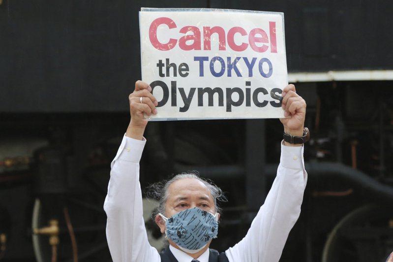 日本發動取消辦奧運,聯署案已達40萬人支持。 美聯社