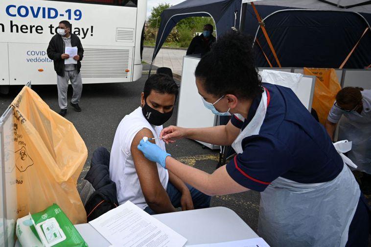 英國研究發現,印度變種病毒新分支B.1.617.2感染力比英國變種病毒B.1.1...