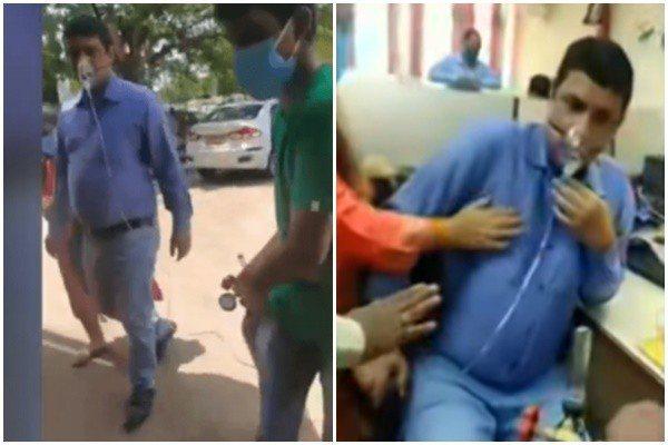 在印度賈坎邦卻爆出,有位銀行行員確診新冠肺炎,想請假在家休息,卻因為「公司不准假」,只好拖著氧氣瓶,氣喘吁吁的走路上班。  圖/《indiaToday》