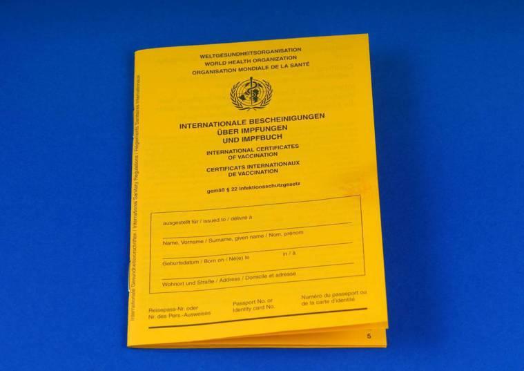 ▲黃色的疫苗護照。(圖:shutterstock)