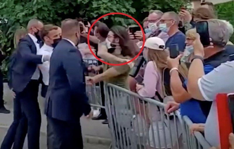 法国总统马克宏8日到东南部一个小镇视察时,被28岁青年塔雷尔(红圈)趁隙打了一记耳光。路透(photo:UDN)