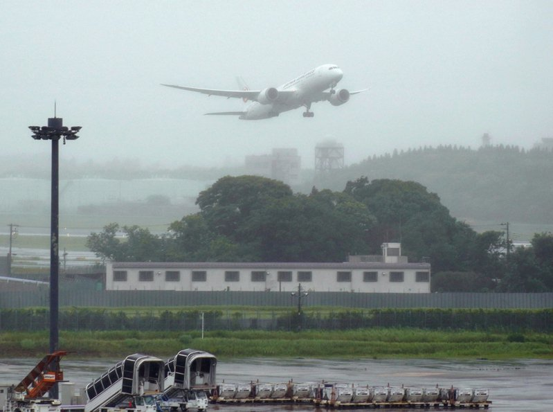 成田機場。 美聯社