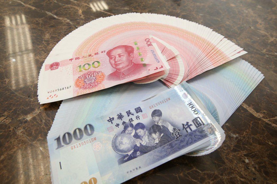 彭博資訊報導,台幣表現可能比人民幣強勢一段時間。   本報系資料庫