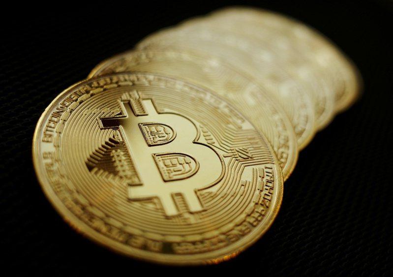 英國警方調查洗錢案,破獲創紀錄2.94億英鎊(約新台幣114億元)加密貨幣。圖/路透