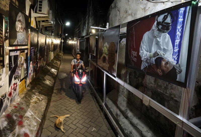 根據旅遊服務業者Collinson集團,亞洲很可能是最晚結束疫情的地區。圖為印尼巷道。美聯社