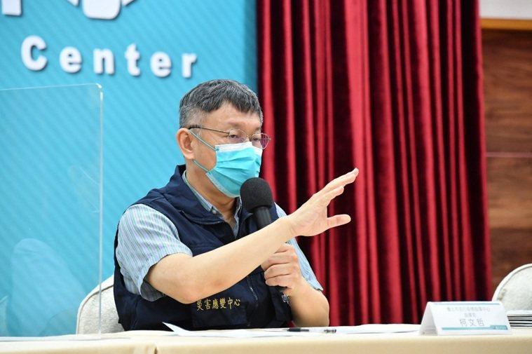 台北市長柯文哲表示,外籍人士接種疫苗資格,將比照台北市民年齡同樣標準。圖/北市府...
