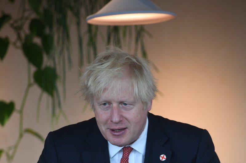 英國首相強生(Boris Johnson)。      Evening Standard Picture  Picture Jeremy Selwyn (Photo by Jeremy Selwyn / POOL / AFP) 法新社