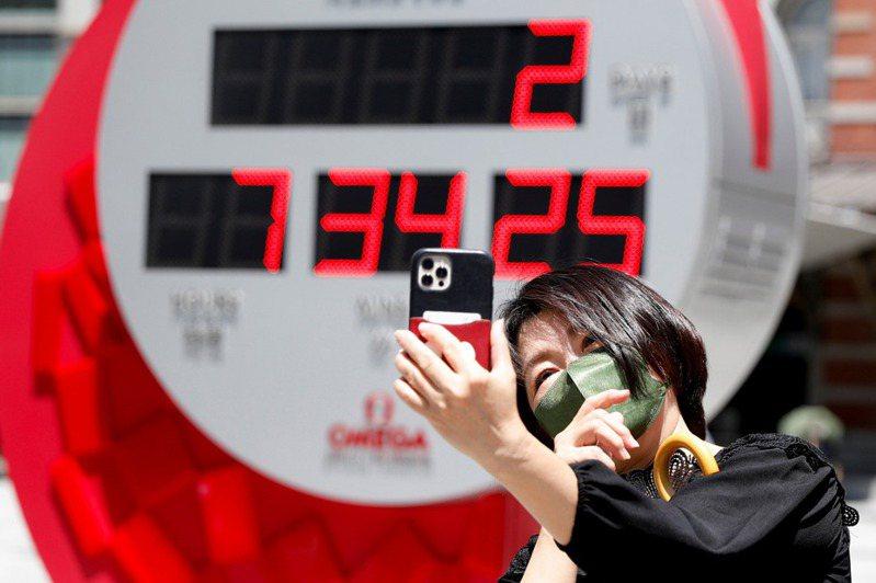 日本首相菅義偉強調舉辦東奧很困難,但「挑戰是政府的職責」。 路透社