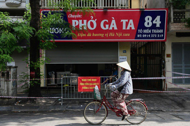 越南今天通報新增6164例COVID-19本土病例,創下紀錄新高,也是首度單日有...