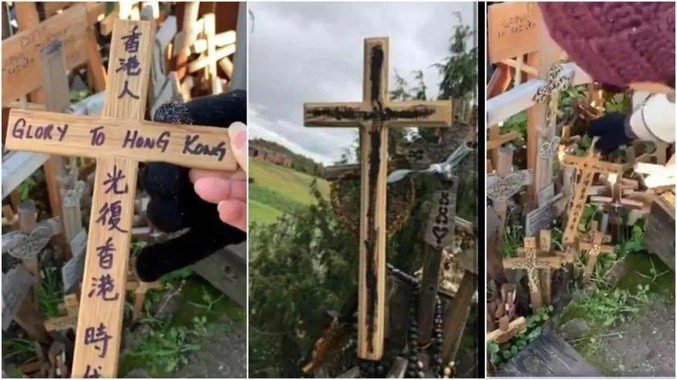 2019年12月28日,有中國遊客或親中遊客破壞十字架山裡寫有支持港人字句之十字...