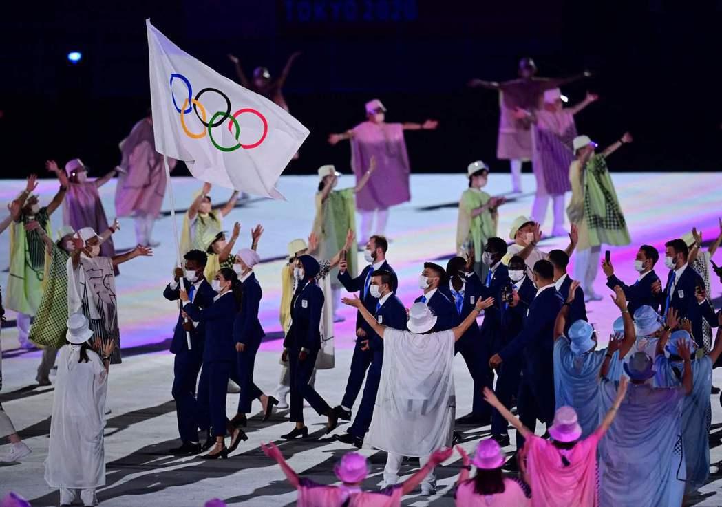 7月23日東奧開幕式,難民代表隊進場。 圖/法新社
