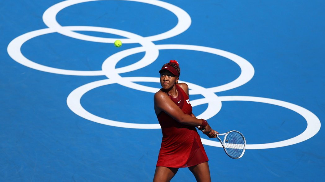 網球選手大坂直美在東京奧運代表日本隊出賽。 圖/路透社