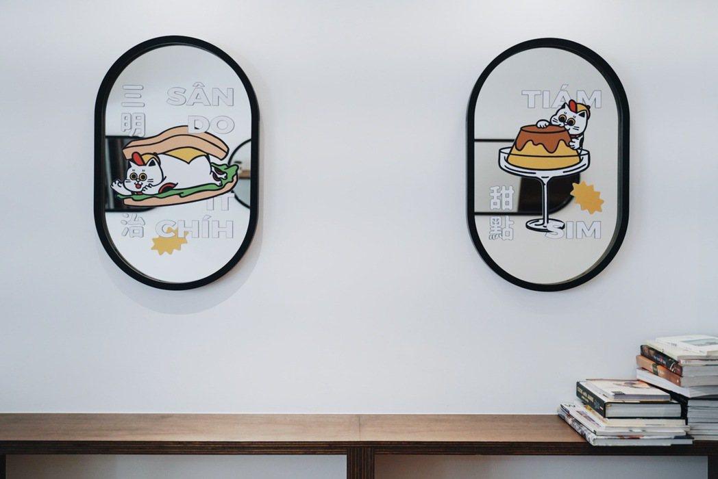 店內使用不少圓角鏡子,呼應招財貓抱著的錢幣形狀。 圖/沈佩臻攝影