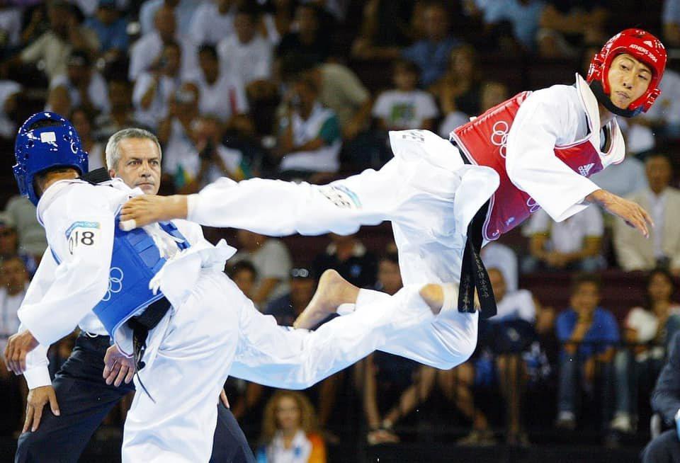 朱木炎(右)當年在奧運場上的英姿令人印象深刻。圖/摘自臉書
