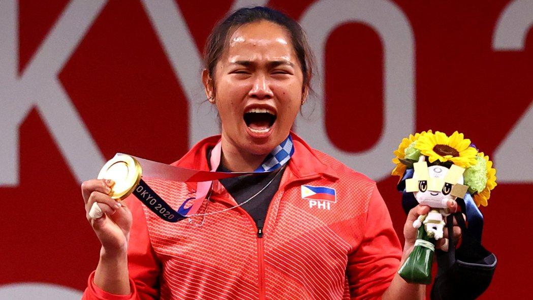 菲國女子舉重選手狄亞士為國家奪下史上第一面金牌。路透
