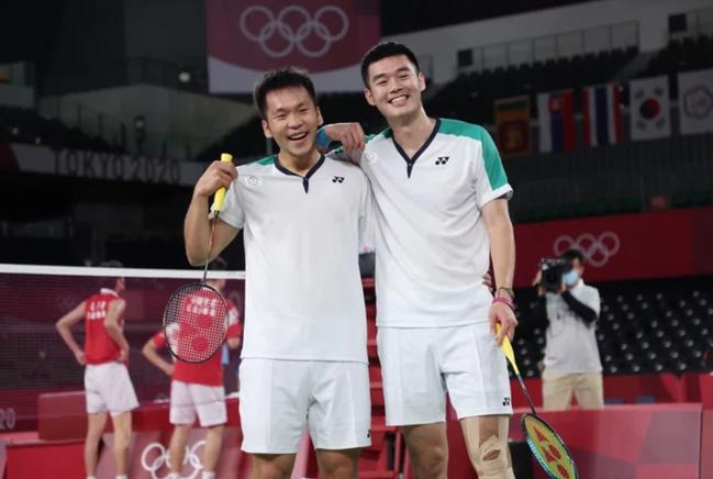 台灣羽球男雙王齊麟(左起)與李洋的「麟洋配」今拿下金牌。特派記者余承翰/東京攝影