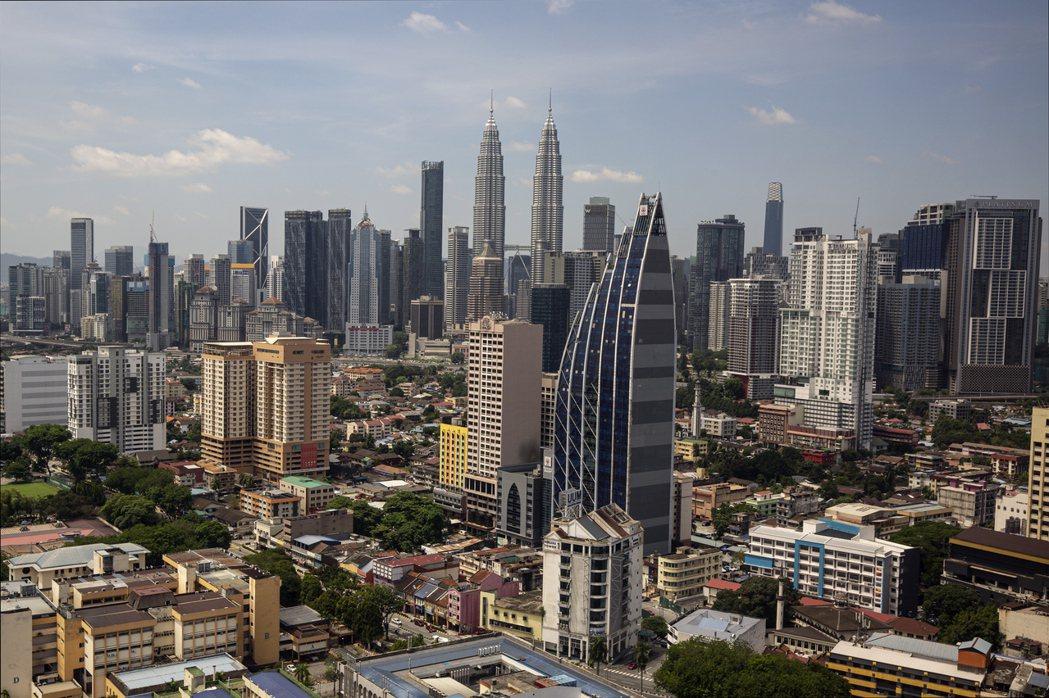 馬來西亞日增染疫人數已經連續21天破萬。歐新社