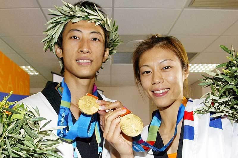 獲得2004年雅典奧運跆拳道雙金的朱木炎(左)及陳詩欣(右)。 圖/聯合報系資料照片