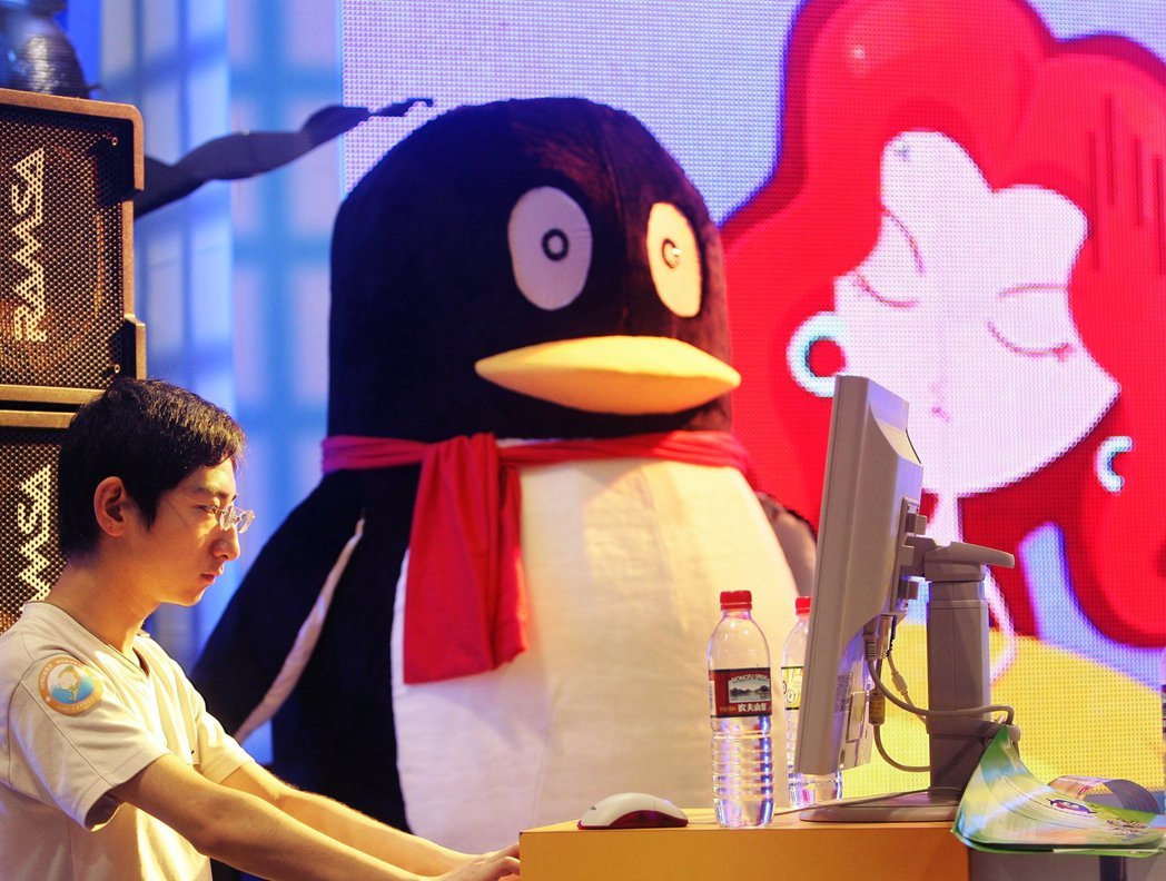 圖為騰訊企鵝與他的玩家夥伴。 圖/法新社