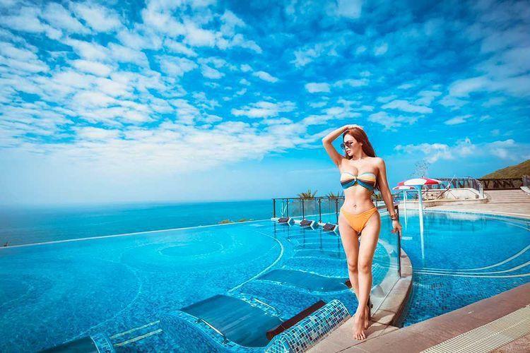 墾丁的椰林沙灘是觀光賣點,掀起旅宿業冠名風潮。圖/H會館提供