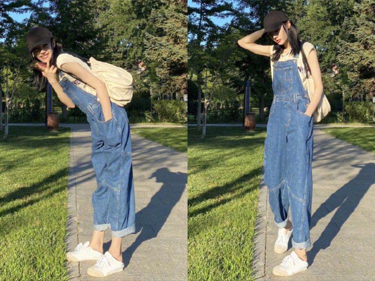迪麗熱巴穿著Urban Outfitters的吊帶丹寧褲、搭襯韓國品牌TWENT...