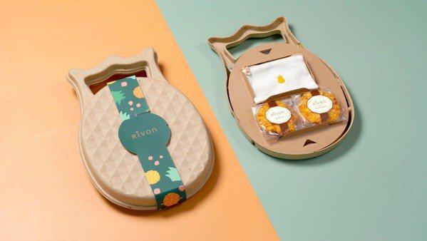 鳳梨酥禮盒的包裝盒是以鳳梨纖維紙漿製成,還附上以鳳梨葉纖維紡織成布製作而成的零錢...