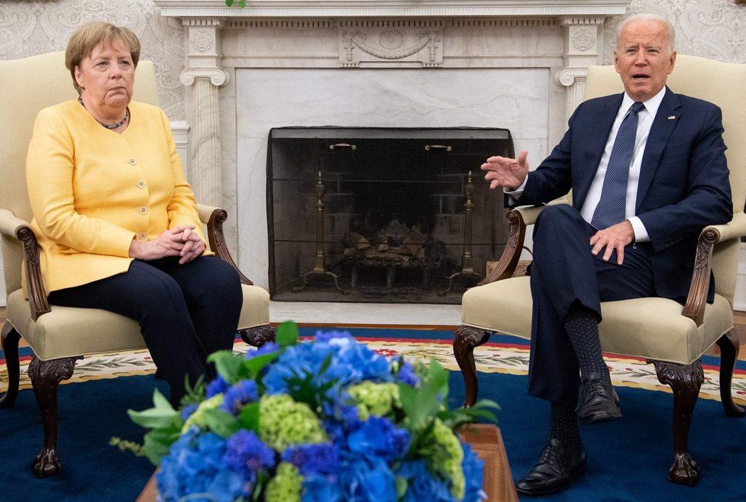 美國總統拜登與德國總理梅克爾,攝於7月。法新社