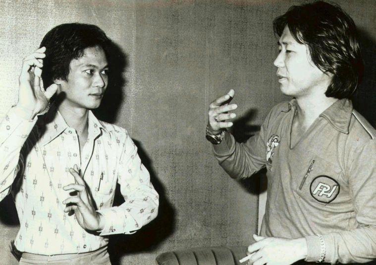 陳軍堡(左)與張鵬翼(右)討論詠春拳技巧。本報資料照片