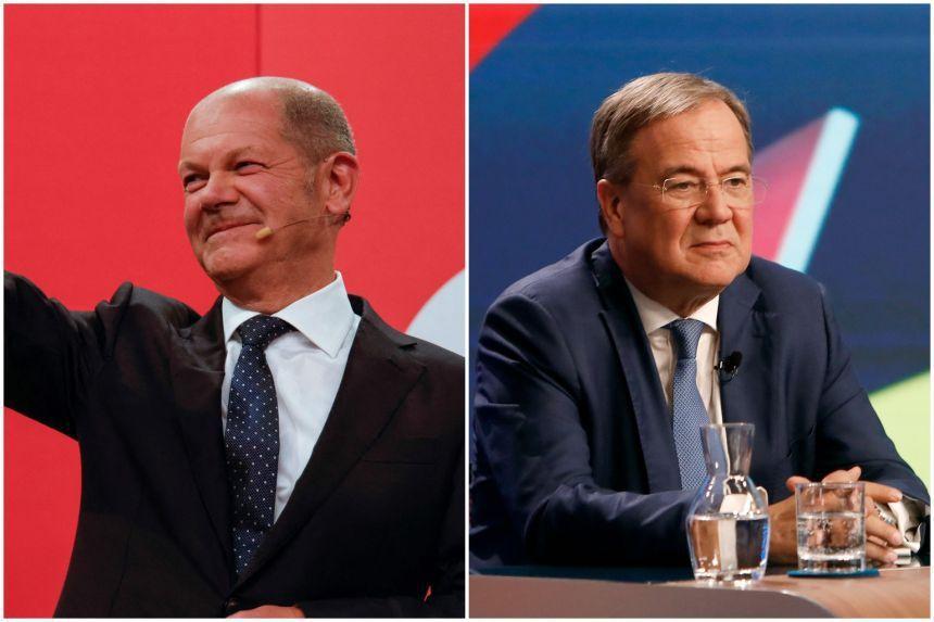 德國國會大選結果出爐,社民黨得票率拔得頭籌,該黨候選人舒茲(左)出任下任總理的機...