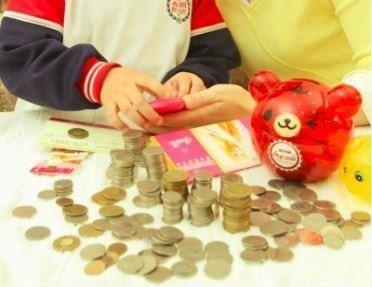 6成台灣父母認為「孩子學習如何做預算和存錢」是最重要4大目標。圖/聯合報系資料照