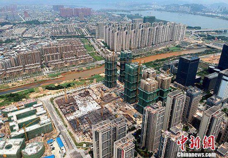 多個城市集中出讓土地,截至10月26日,全國超過22個城市土地出讓累計收入超過500億元。(中新社資料照片)