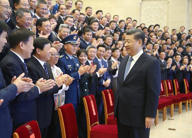 習近平20日在北京會見精神文明建設大會代表。(新華社)